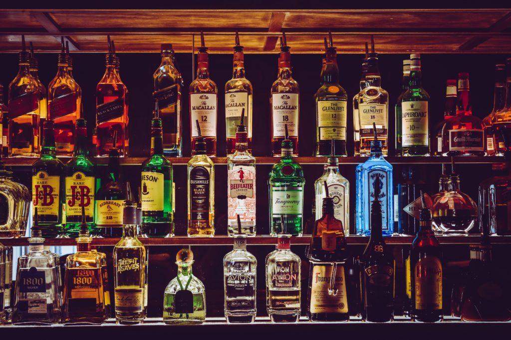 stocked alcohol bottles bar